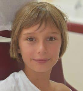 Photo du visage de Charline à la fin du traitement OSB.